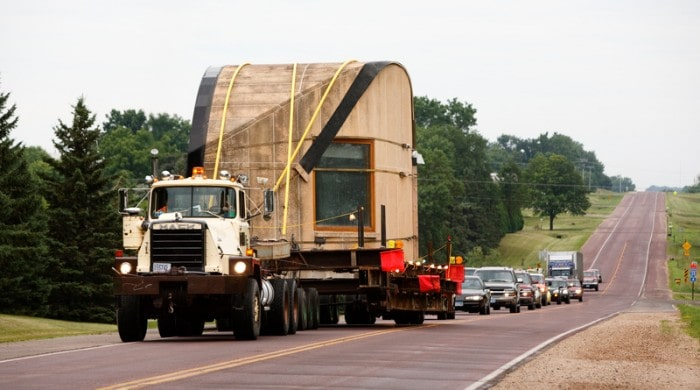 This is a look at the truck carrying the sections of the house to be moved. Image courtesy of Toptenrealestatedeals.com.
