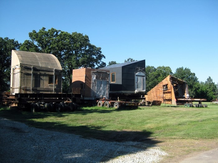 This is a look at the different sections of the house dismantled and placed on trucks to be moved. Image courtesy of Toptenrealestatedeals.com.