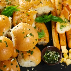 A variety of garlic and cheese dinner rolls.