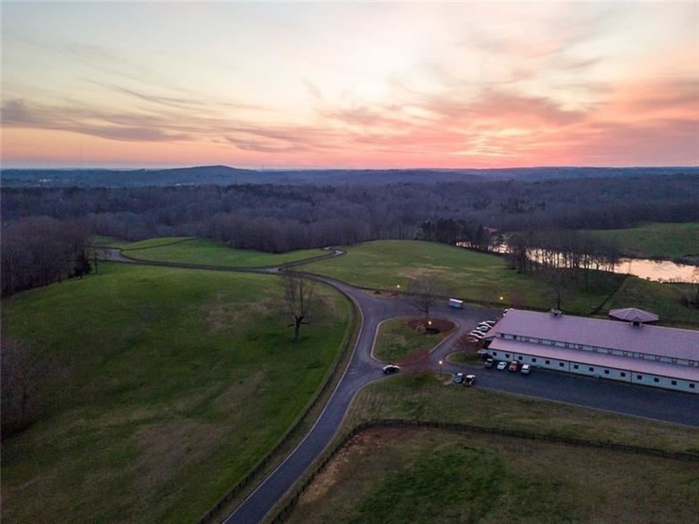 This is an aerial view of the large car-collector's showroom with grass lawns traversed by wide driveways. Image courtesy of Toptenrealestatedeals.com.