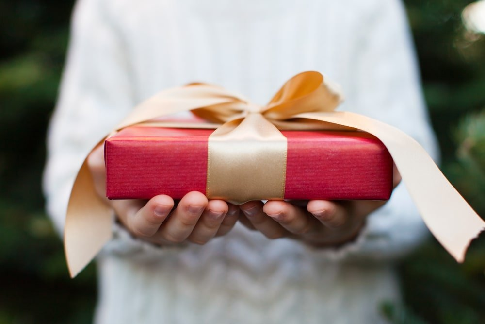 A person offering a gift.