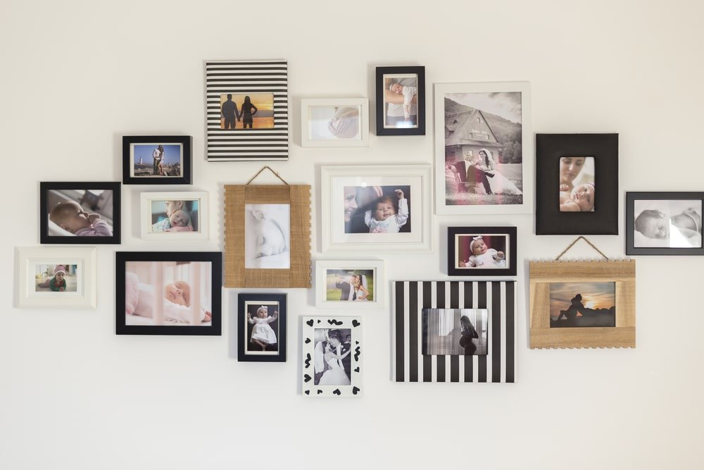 A wall of photos in different frames.