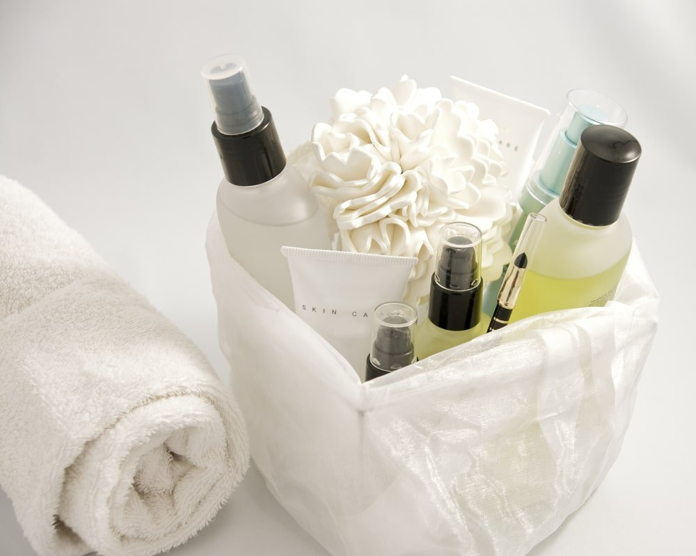 A bunch of skin care products in a basket.