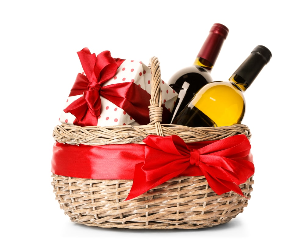 A basket with a gift and a couple of wine.