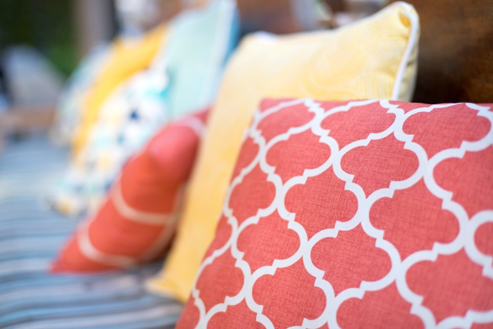 A close look at colorful throw pillows.