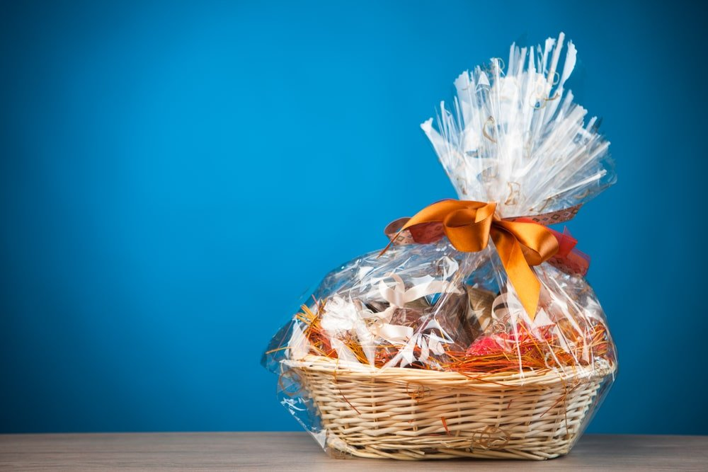 A gift basket with a plastic wrap.