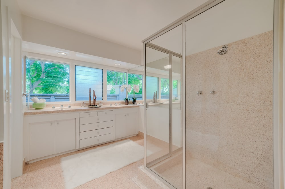 This other view of the bathroom shows the glass-enclosed shower area across from the large vanity. Image courtesy of Toptenrealestatedeals.com.