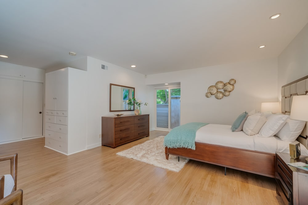 This angle of the bedroom features a wooden dresser across from the wooden bed. Image courtesy of Toptenrealestatedeals.com.
