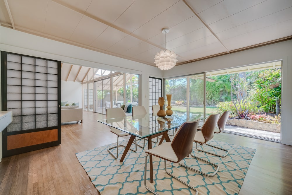 This is a closer look at the dining room that is bathed with natural lights from the glass doors that brighten the beige walls and ceiling. Image courtesy of Toptenrealestatedeals.com.