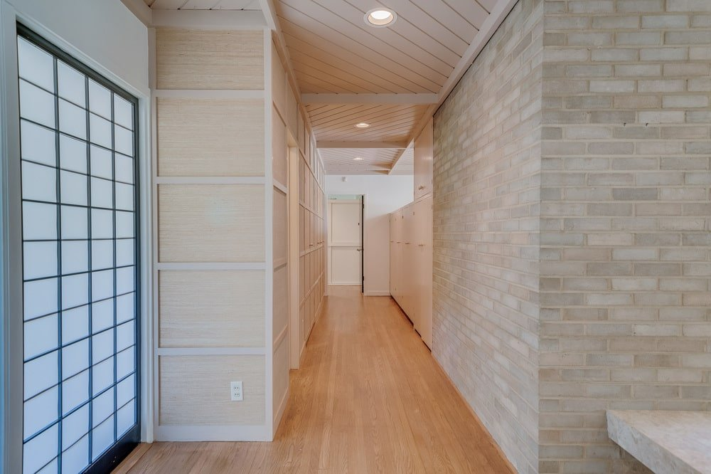 This is the hallway of the house behind the stone wall of the fireplace. Image courtesy of Toptenrealestatedeals.com.