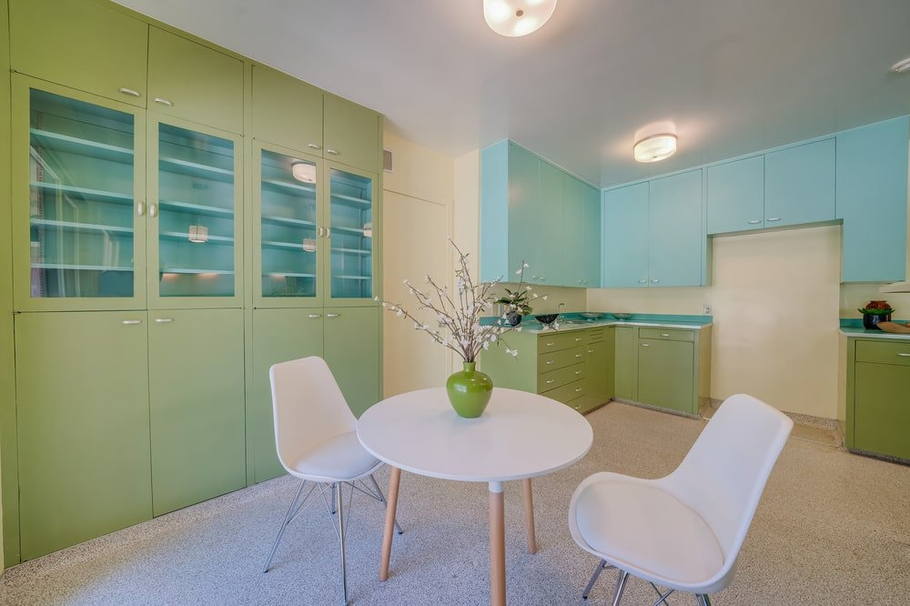 This is a close look at the informal dining area of the kitchen with a round table paired with a couple of white chairs. Image courtesy of Toptenrealestatedeals.com.