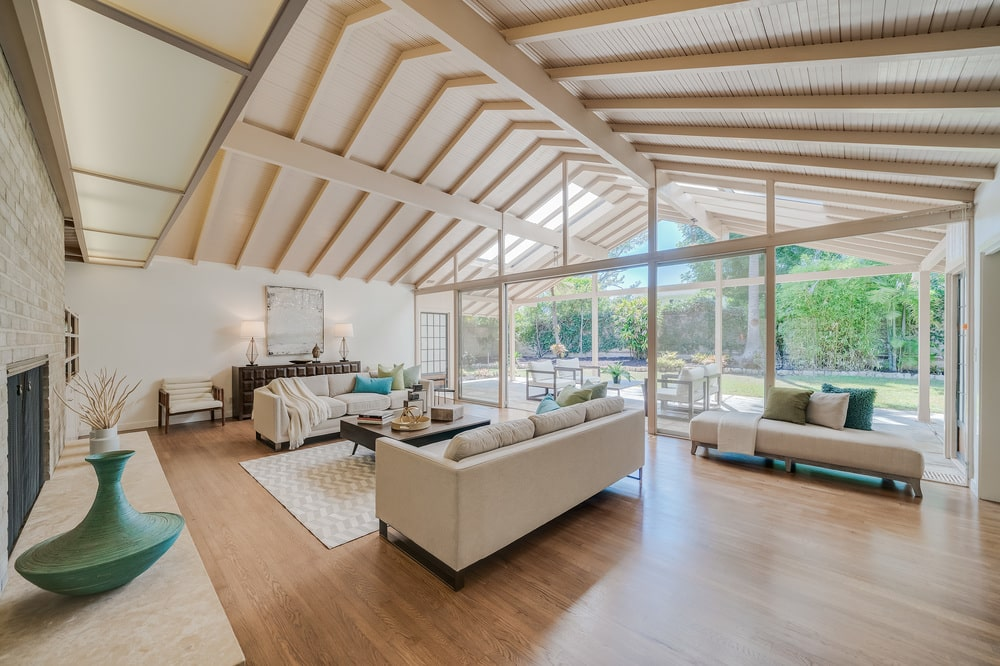 This is another look at the living room with beige sofas complemented by the hardwood flooring. Image courtesy of Toptenrealestatedeals.com.