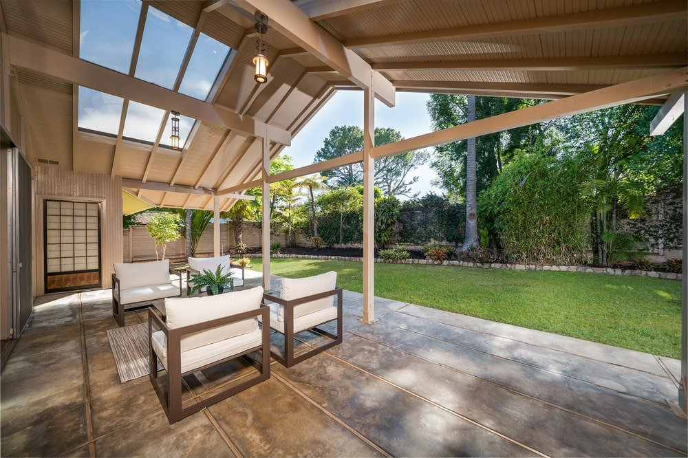 This is the covered patio with a tall cathedral ceiling and a skylight. Image courtesy of Toptenrealestatedeals.com.