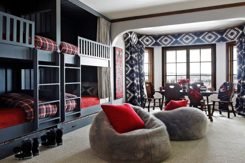 This gorgeous bedroom offers two sets of bunk beds and a personal dining table set near the windows. Image courtesy of Toptenrealestatedeals.com.