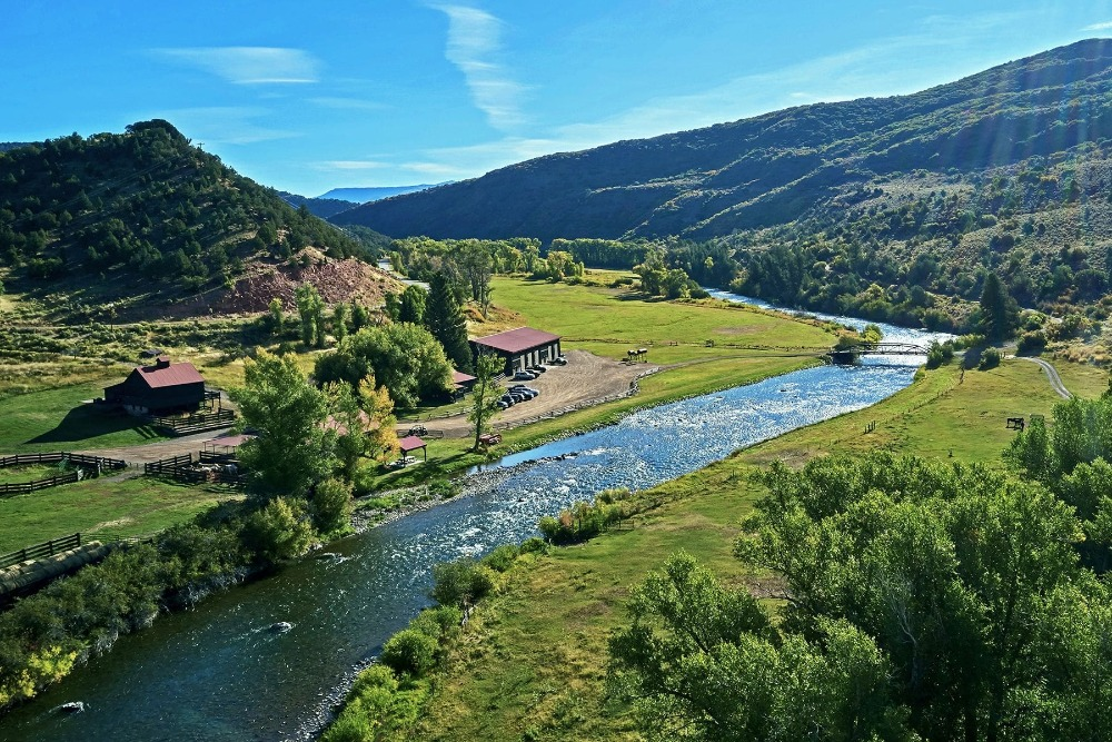 This aerial view showcases the river stream and the green surroundings. Image courtesy of Toptenrealestatedeals.com.