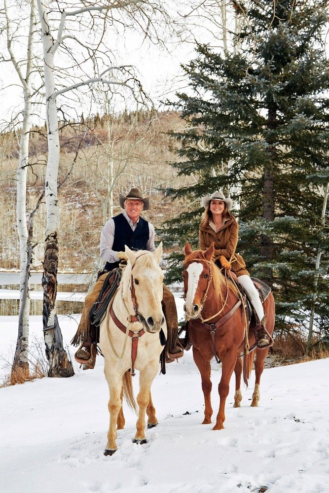 Greg Norman with his wife, horse riding during the winter. Image courtesy of Toptenrealestatedeals.com.