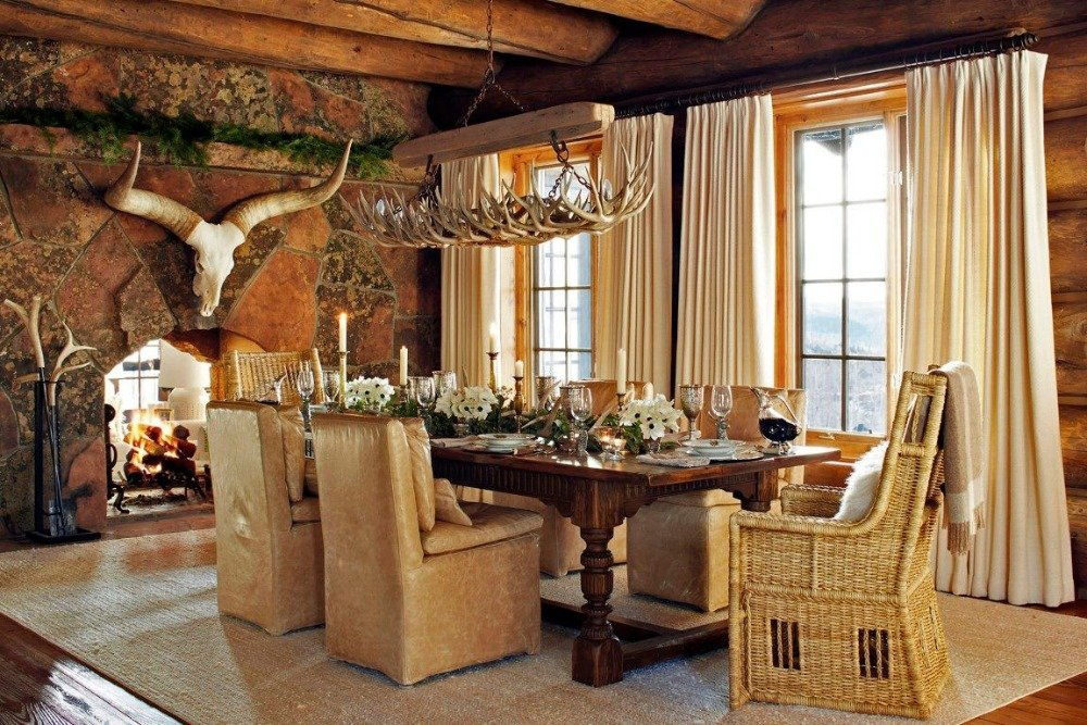 Formal dining room boasting an elegant dining table and chairs set with a gorgeous fireplace and stunning ceiling lighting. Image courtesy of Toptenrealestatedeals.com.