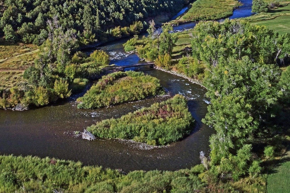 Here's the river streaming calmly with two landscape in the middle. Image courtesy of Toptenrealestatedeals.com.