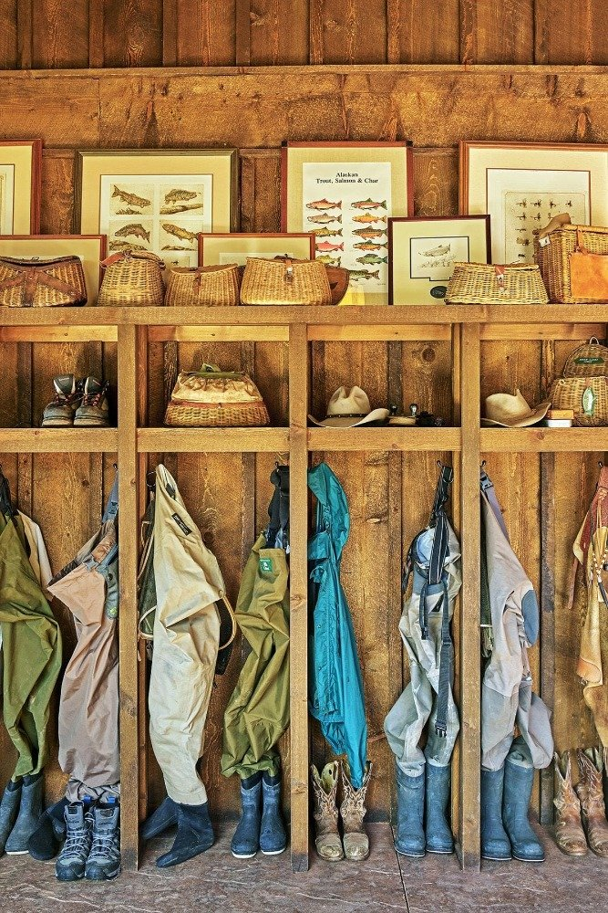A mudroom with rustic walls and ceiling along with built-in shelving. Image courtesy of Toptenrealestatedeals.com.