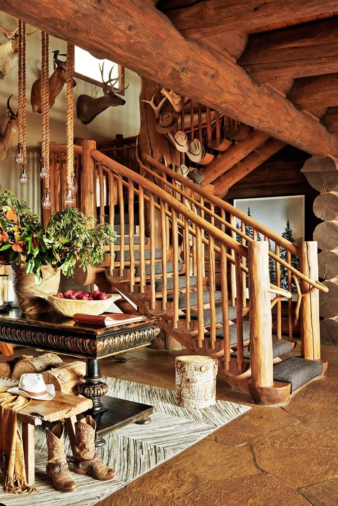 Focused look at the home's wooden staircase with carpeted steps. Image courtesy of Toptenrealestatedeals.com.