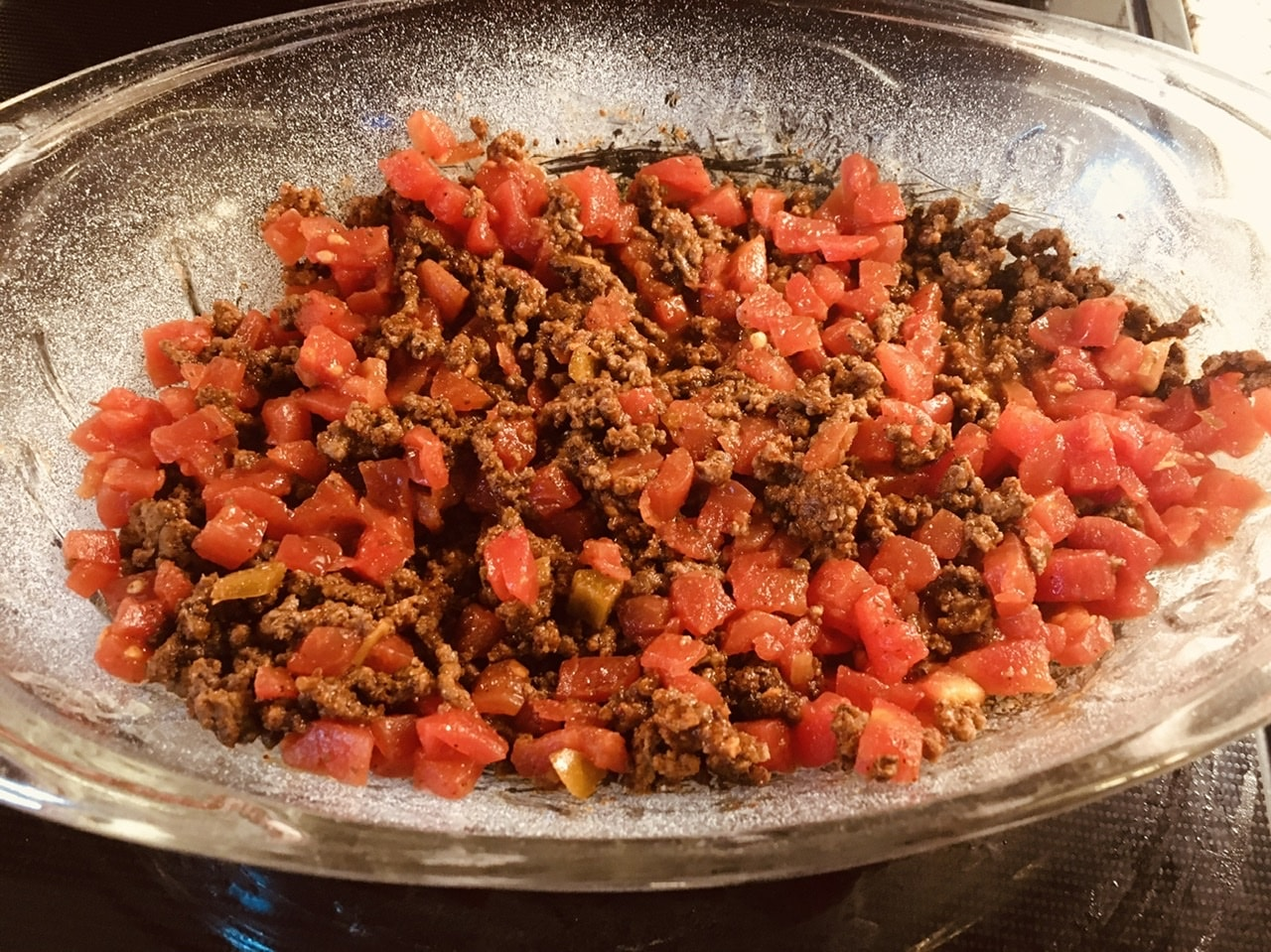 Baked ground beef with diced tomatoes and chilis.