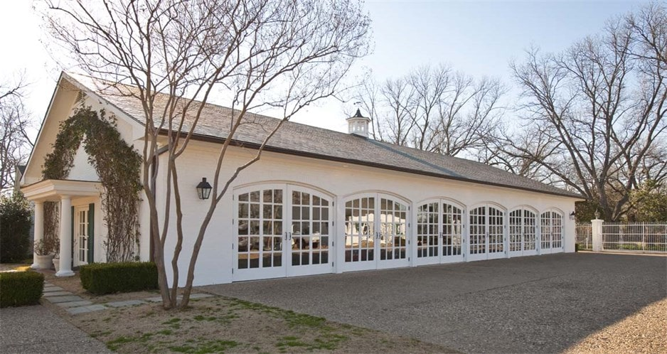 This is an outside look at the large showroom garage that can fit up to sixteen cars. Image courtesy of Toptenrealestatedeals.com.