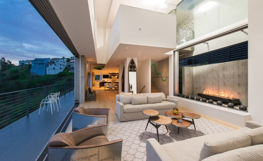 This angle of the living room shows the tall ceiling and the indoor balcony of the loft above. Image courtesy of Toptenrealestatedeals.com.