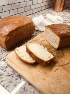 Two loaves of white sandwich bread freshly baked.