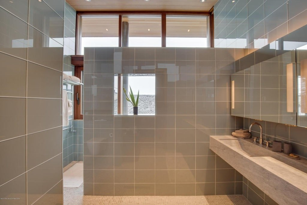 This other bathroom has a floating sink that matches the tiles of the divider that leads to the shower area. Image courtesy of Toptenrealestatedeals.com.