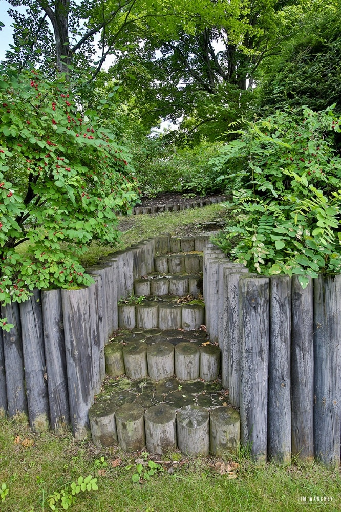 This is a set of stone steps made of the same material as the low wall that serves as a planter for the various shrubs. Image courtesy of Toptenrealestatedeals.com.