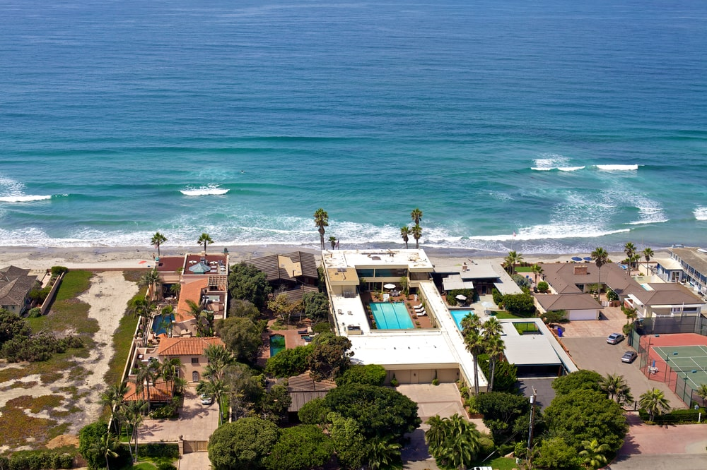 This is an aerial view of the square-shaped mansion showing the open area in the middle where the pool is. Image courtesy of Toptenrealestatedeals.com.