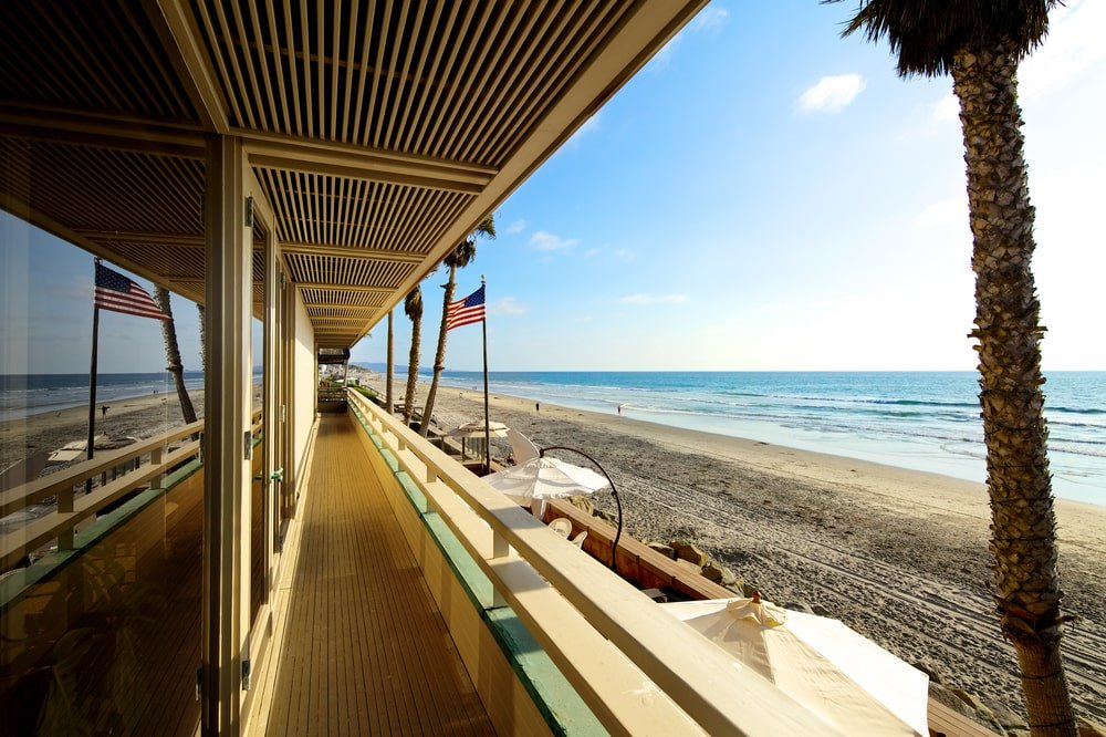 This is the balcony just outside the glass doors of the bedrooms. It has a sweeping view of the beach below as well as the entertainment deck. Image courtesy of Toptenrealestatedeals.com.