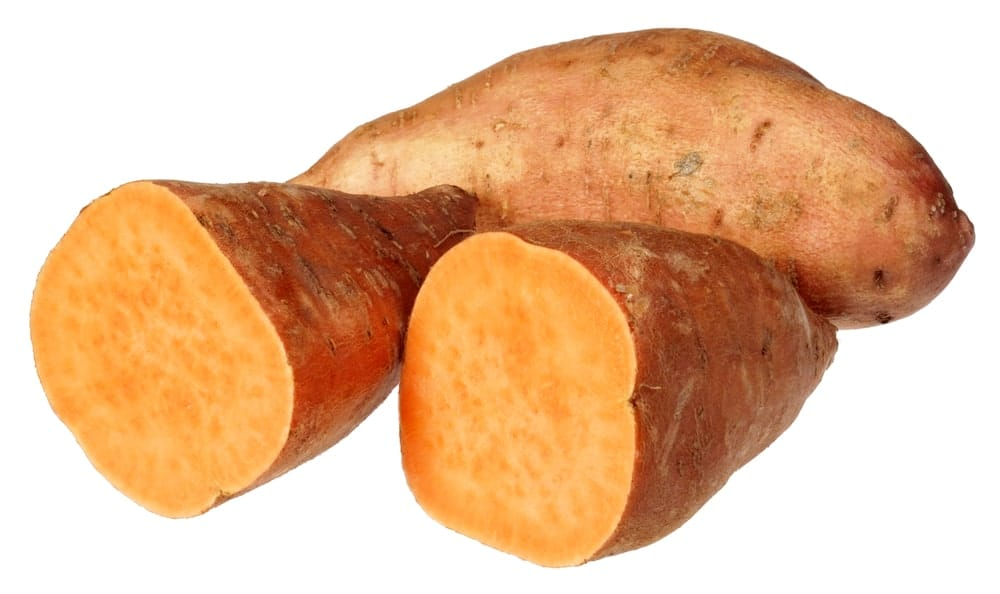 Jewel sweet potatoes cut in half.