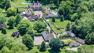 This is an aerial view of the mansion and its surrounding landscape. You can see here the tall trees and spacious grass lawns that complement the earthy tone of the house exteriors. Image courtesy of Toptenrealestatedeals.com.