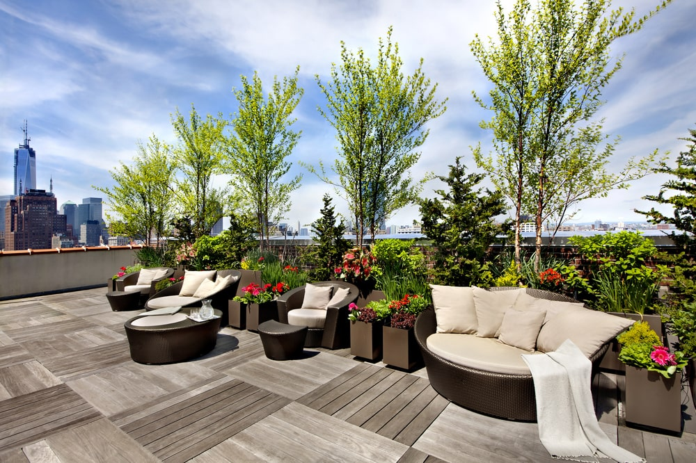 This is a closer look at the edge of the terrace area with various potted plants and various sitting areas to better enjoy the surrounding scenic views. Image courtesy of Toptenrealestatedeals.com.