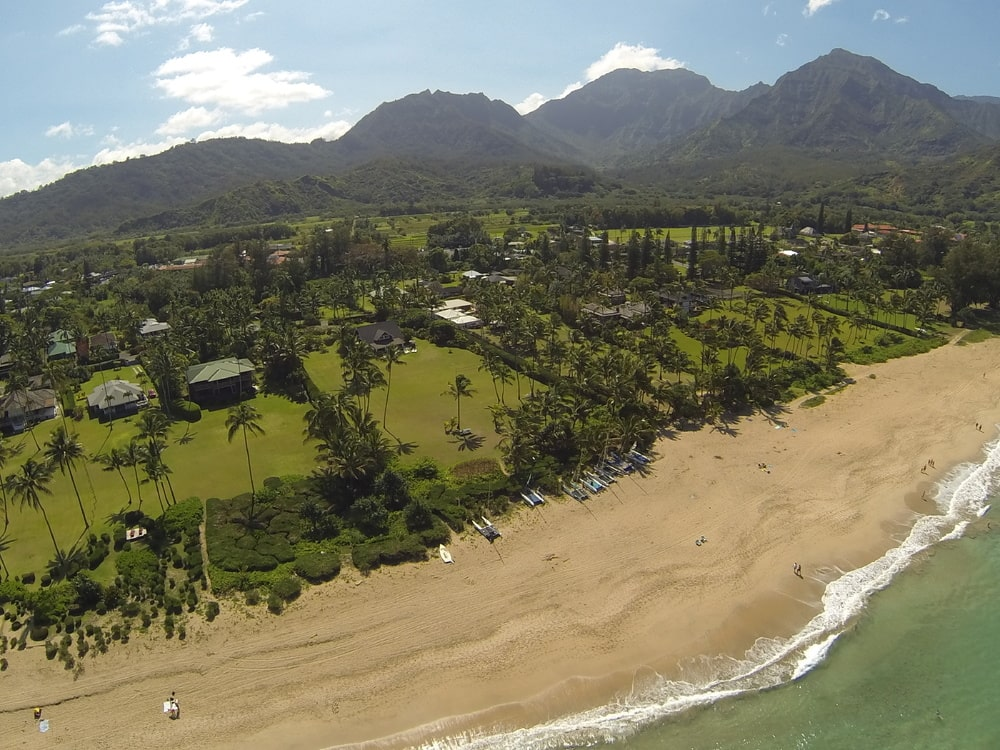 This aerial view of the property shows the row of beachfront properties of the neighborhood along with the tall mountains in the distance. Image courtesy of Toptenrealestatedeals.com.