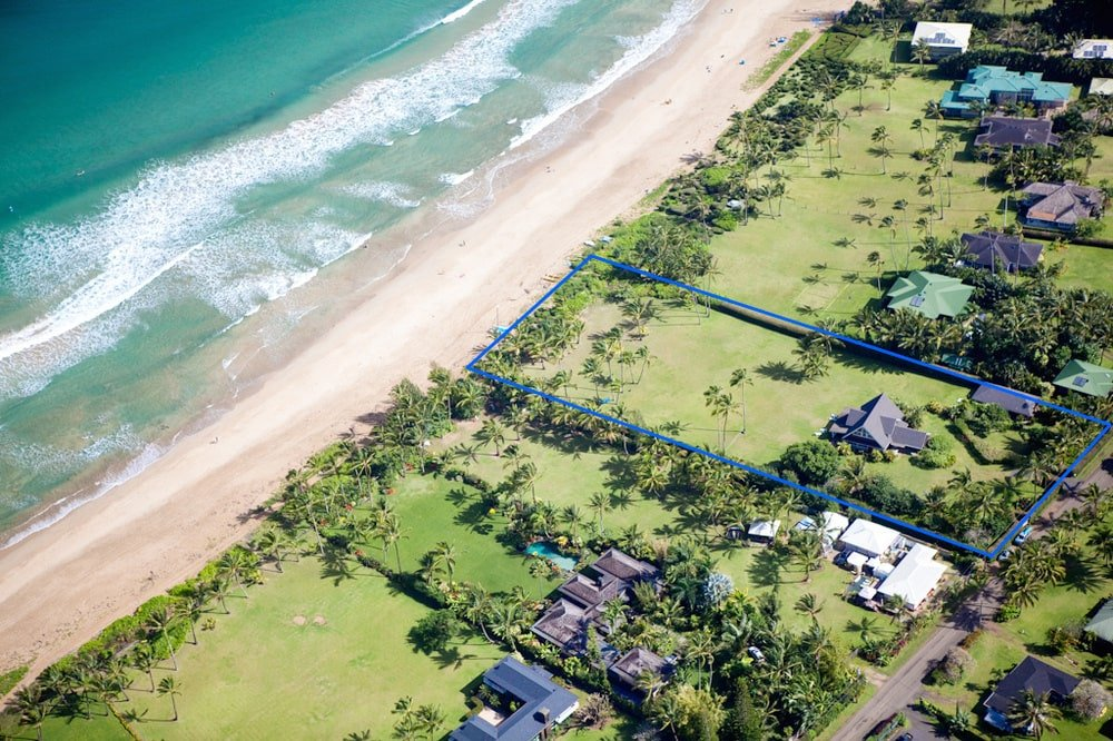 This is a far aerial view that depicts the property line with blue lines. Image courtesy of Toptenrealestatedeals.com.