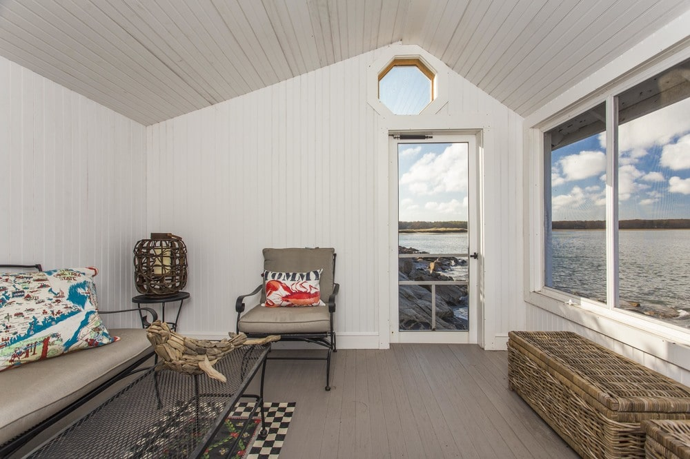 This is a look at the interior of the oceanside cottage fitted with a living room. Image courtesy of Toptenrealestatedeals.com.