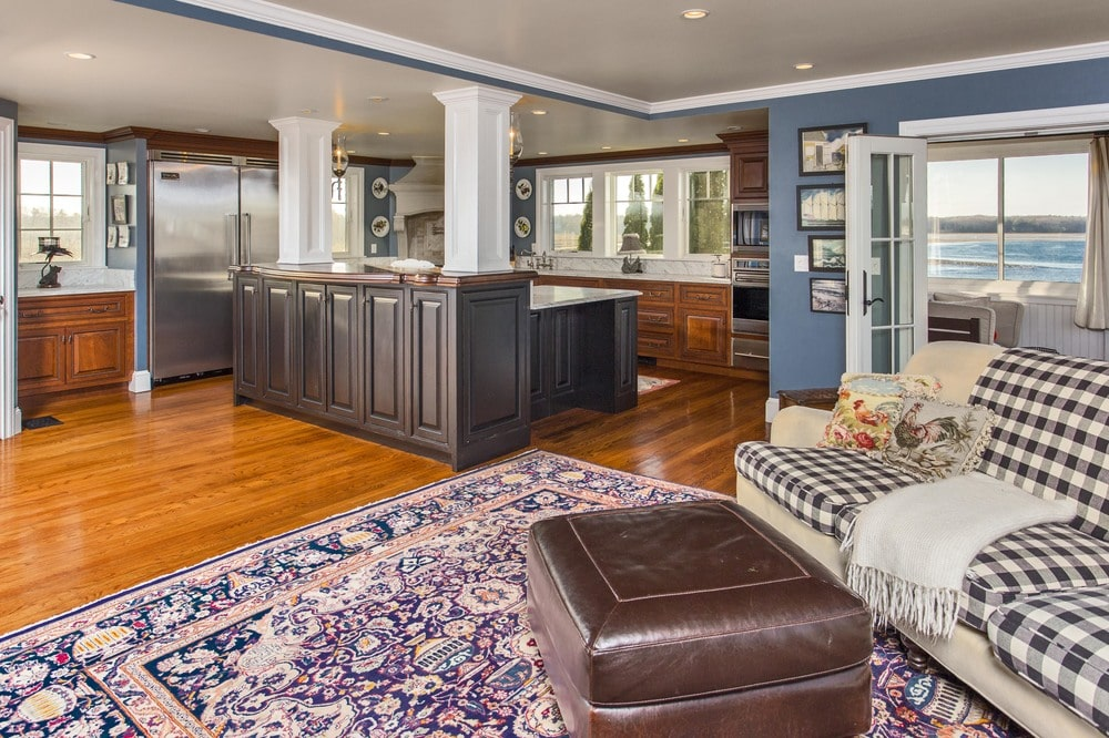 This is a view of the kitchen from the vantage of the other living room. You can see here that the kitchen island is attached to the white ceiling through the two white pillars. Image courtesy of Toptenrealestatedeals.com.