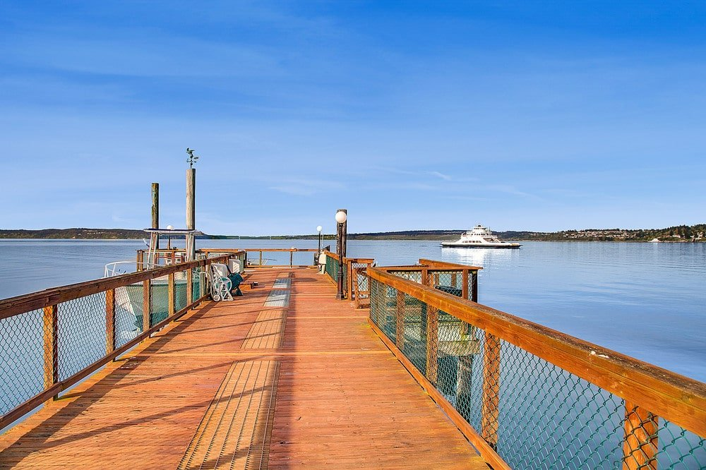 This wooden walkway leads to the dock at the far end. Image courtesy of Toptenrealestatedeals.com.