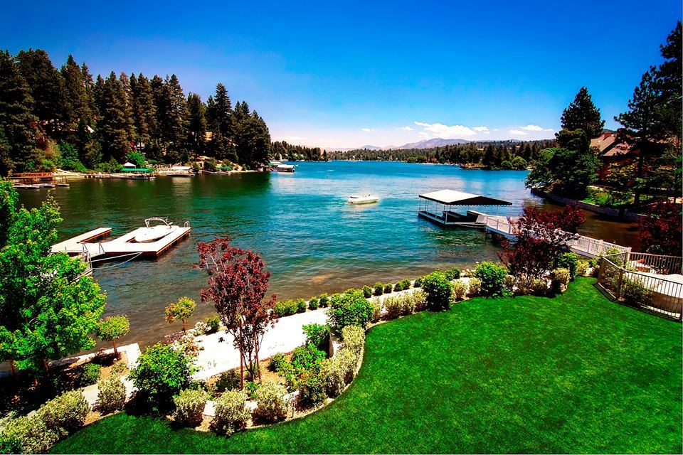 This is a look at the lakefront lawn from the vantage of the balcony. You can also see here that it leads to the dock and boathouse. Image courtesy of Toptenrealestatedeals.com.