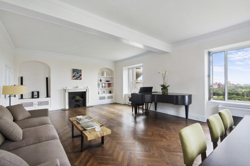 This is the great room of the apartment featuring a grand piano, a living room with fireplace and a dining area. Image courtesy of Toptenrealestatedeals.com.