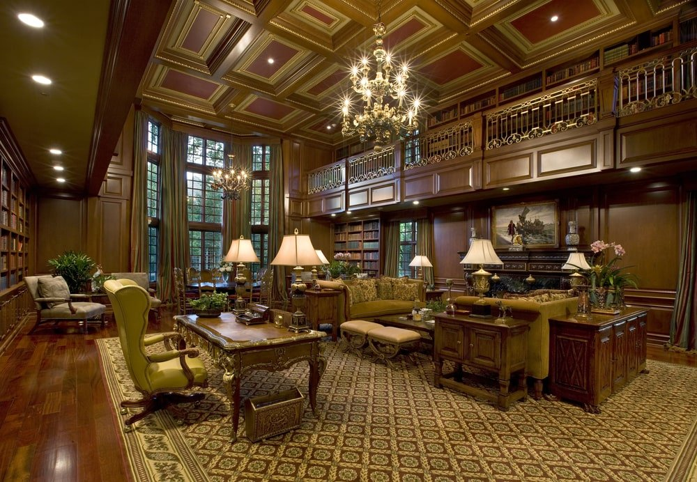 This other view of the library shows the second level with an indoor balcony and the large two-story windows at the far end. Image courtesy of Toptenrealestatedeals.com.