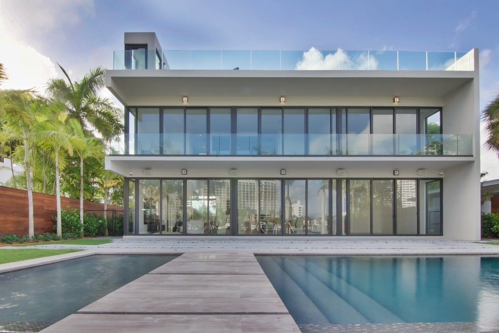 Exterior view of this Miami Beach mansion showcasing its gorgeous architecture and outdoor swimming pool.
