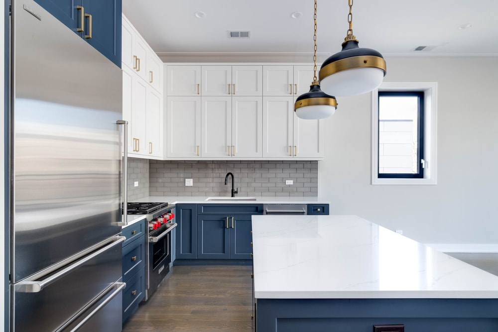 Blue and white-themed kitchen with subway tiles.