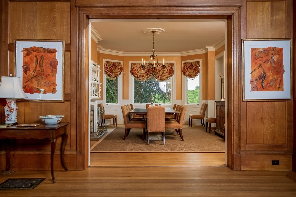 This is a look at the dining room from the vantage of the foyer that has consistent hardwood flooring, walls and molding. Image courtesy of Toptenrealestatedeals.com.
