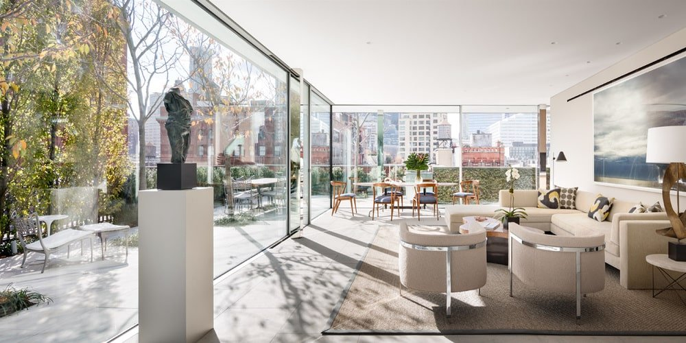 This is the large room with a brightness to it that comes from the natural lights coming in from the glass walls. You can see here the living room with a beige sofa set to complement the brightness. Image courtesy of Toptenrealestatedeals.com.