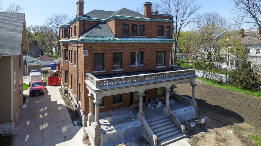 This aerial view of the front of the house shows the second level balcony just above the front porch. Image courtesy of Toptenrealestatedeals.com.