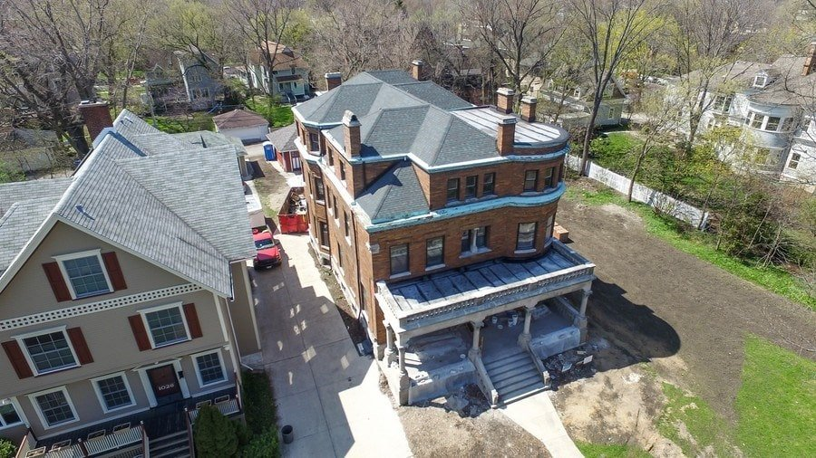 This aerial view of the house showcases the dark-toned roof and the chimneys. You can also see here the driveway on the side. Image courtesy of Toptenrealestatedeals.com.