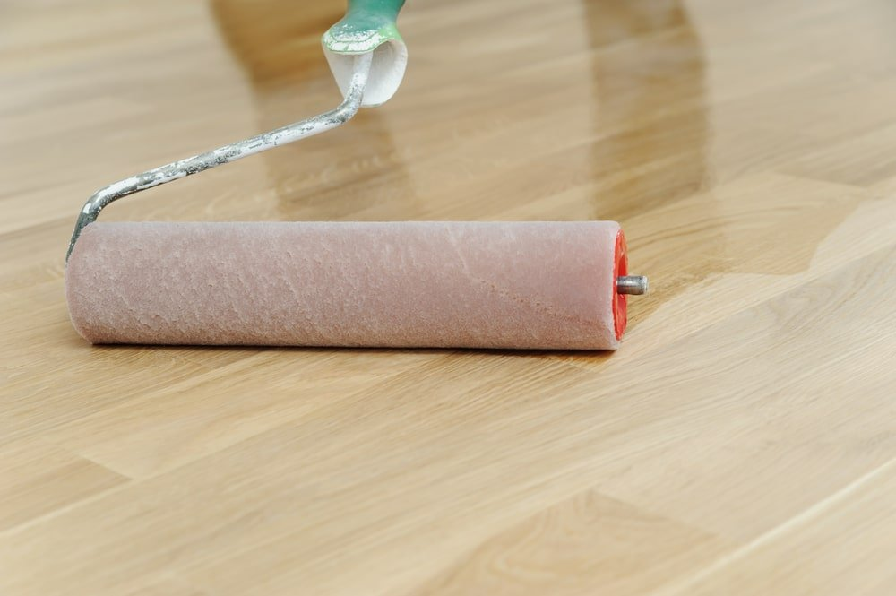Paint roller used for coating a wooden flooring.